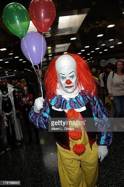 Cosplayer dressed as Pennywise from Stephen King's 'It' attends Day 2 of Wizard World Chicago Comic Con held at Donald E Stephens Convention Center...