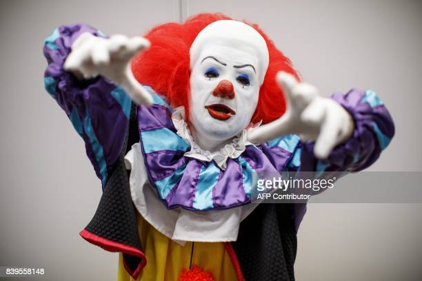 A cosplayer dressed as Pennywise the Dancing Clown attends London Super Comic Convention at Business Design Centre in Islington London on August 26...