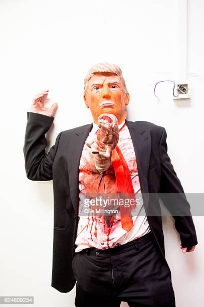 A cosplayer dressed as President Donald Trump with an Alien Xenomorph bursting out his ribs on day 2 of the November Birmingham MCM Comic Con at the...