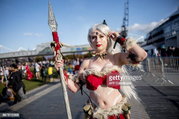 A cosplayer dressed as Snow Bunny Nidalee from League of Legends attends the MCM Comic Con at ExCeL exhibition centre in London on October 29 2017 /...