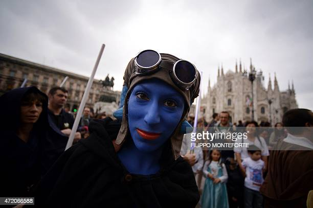 A cosplayer dressed as 'Star Wars' character Aayla Secura poses near Milan's Duomo on May 3 2015 as part of Star Wars Day AFP PHOTO / FILIPPO...