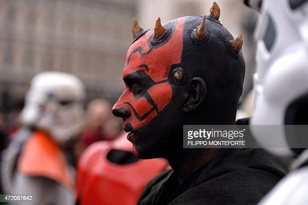 A cosplayer dressed as 'Star Wars' character Darth Maul attends a Star Wars Day event in Milan on May 3 2015 AFP PHOTO / FILIPPO MONTEFORTE