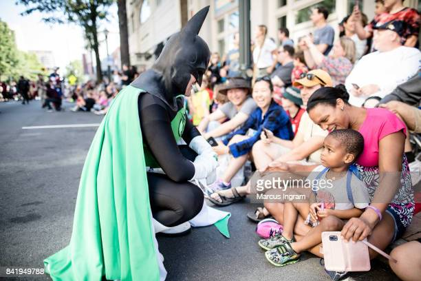 Cosplayer dressed in their favorite character greet fans at the 2017 DragonCon Parade on September 2 2017 in Atlanta Georgia DragonCon is a...