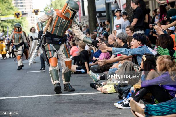 Cosplayer dressed in their favorite character greet fans during the 2017 DragonCon Parade on September 2 2017 in Atlanta Georgia DragonCon is a...