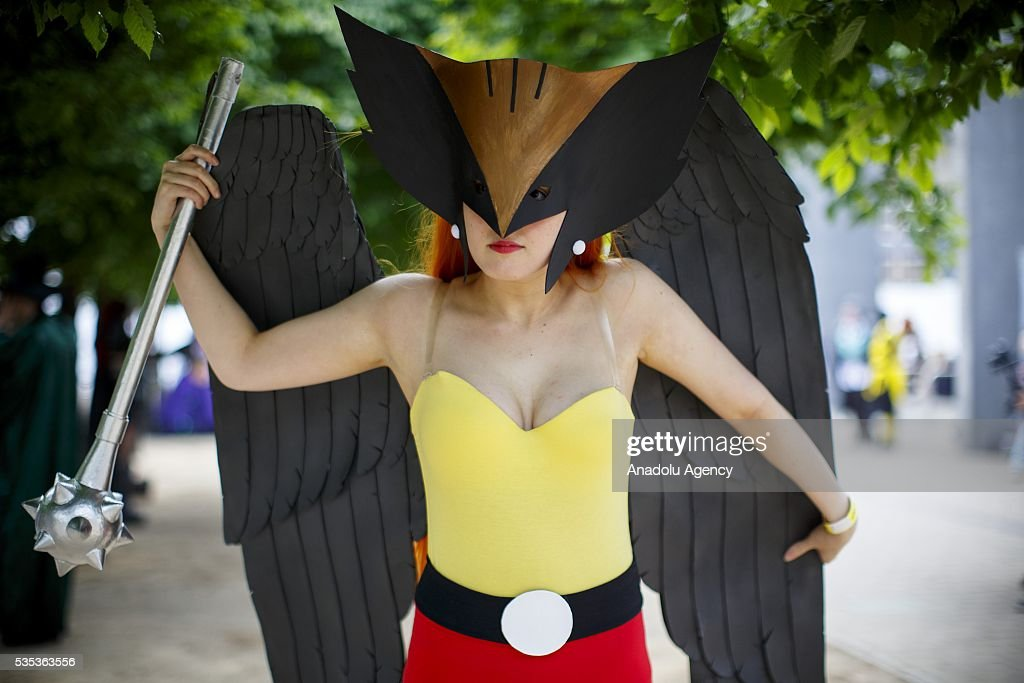 A cosplayer holds her wings and mace during MCM Comic Con at ExCeL convention centre in London, England on May 29, 2016.