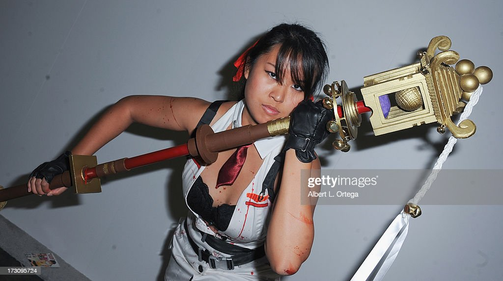 Cosplayer Jessica Lam as Momiji from 'Clear Echoes' attends the Anime Expo (AX) 2013 held at The Los Angeles Convention Center on July 6, 2013 in Los Angeles, California.