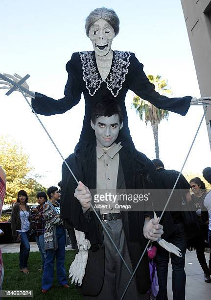 Cosplayer Joe Youngblood dressed as Norman Bates from 'Psycho' attends Son Of Monsterpalooza 2013 at Burbank Airport Marriott on October 12 2013 in...