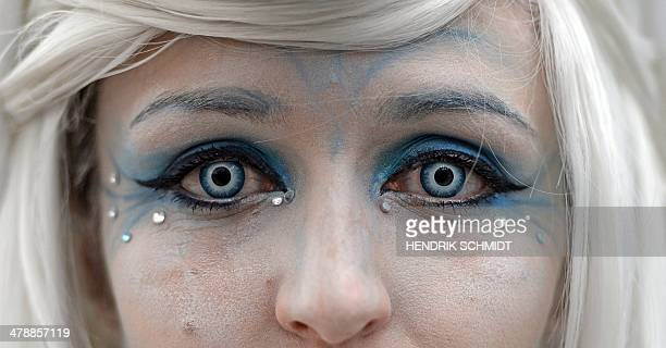 A Cosplayer looks into the camera with coloured contact lenses at the Leipzig Book Fair in Leipzig eastern Germany on March 15 2014 The book fair...