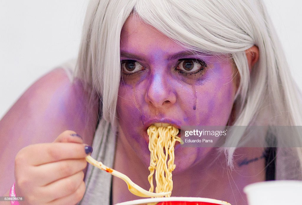 A cosplayer participates in the eating spicy Ramen competition at the fair Expomanga at IFEMA on May 07 2016 in Madrid Spain