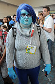 A cosplayer portrays 'Sadness' from 'Inside Out' during ComicCon International 2015 on July 8 2015 in San Diego California