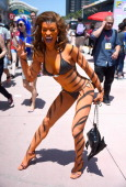 A cosplayer portrays Tigra the WereWoman Day 3 of ComicCon International 2014 on July 26 2014 in San Diego California