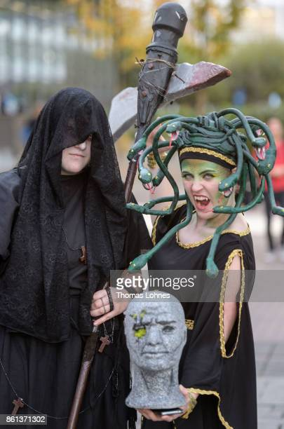 Cosplayer pose as 'Medusa' and 'Martha' of the game 'Outlast 2' the 2017 Frankfurt Book Fair on October 14 2017 in Frankfurt am Main Germany The 11th...