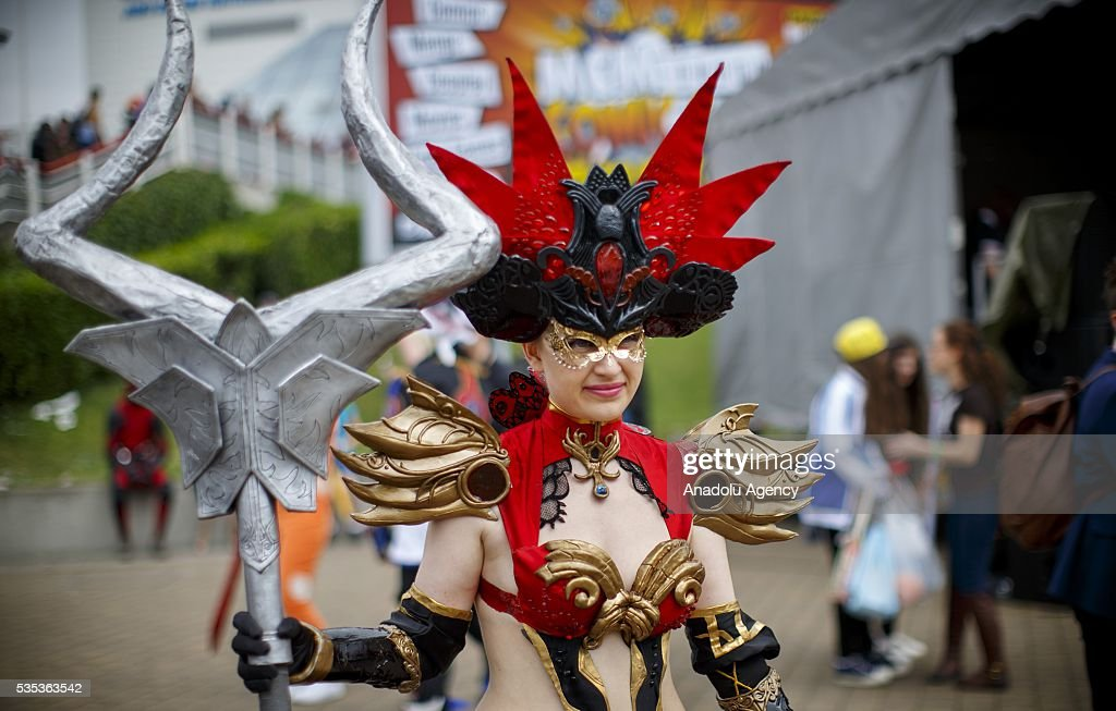 A cosplayer pose for a photo during MCM Comic Con at ExCeL convention centre in London, England on May 29, 2016.