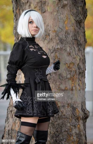 A cosplayer poses as '2B' of the game 'Nier' at the 2017 Frankfurt Book Fair on October 14 2017 in Frankfurt am Main Germany The 11th German Cosplay...