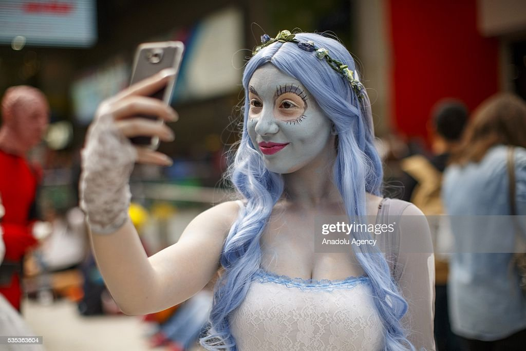 A cosplayer takes a selfie during MCM Comic Con at ExCeL convention centre in London, England on May 29, 2016.