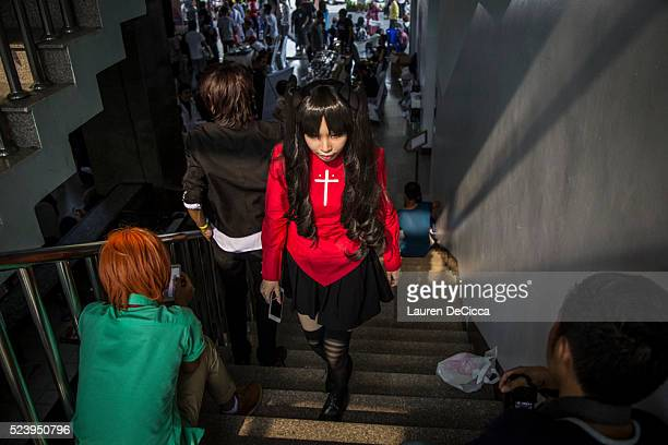 A cosplayer walks upstairs to the dressing room at the end of the days events on April 24 2016 in Yangon Burma Hundreds of youths between 16 to 24...