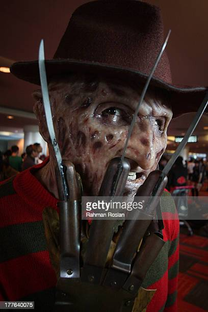 Cosplayer who dresses up as Freddy Krueger poses for a photograph during the final day of AniManGaki on August 25 2013 in Kuala Lumpur Malaysia...