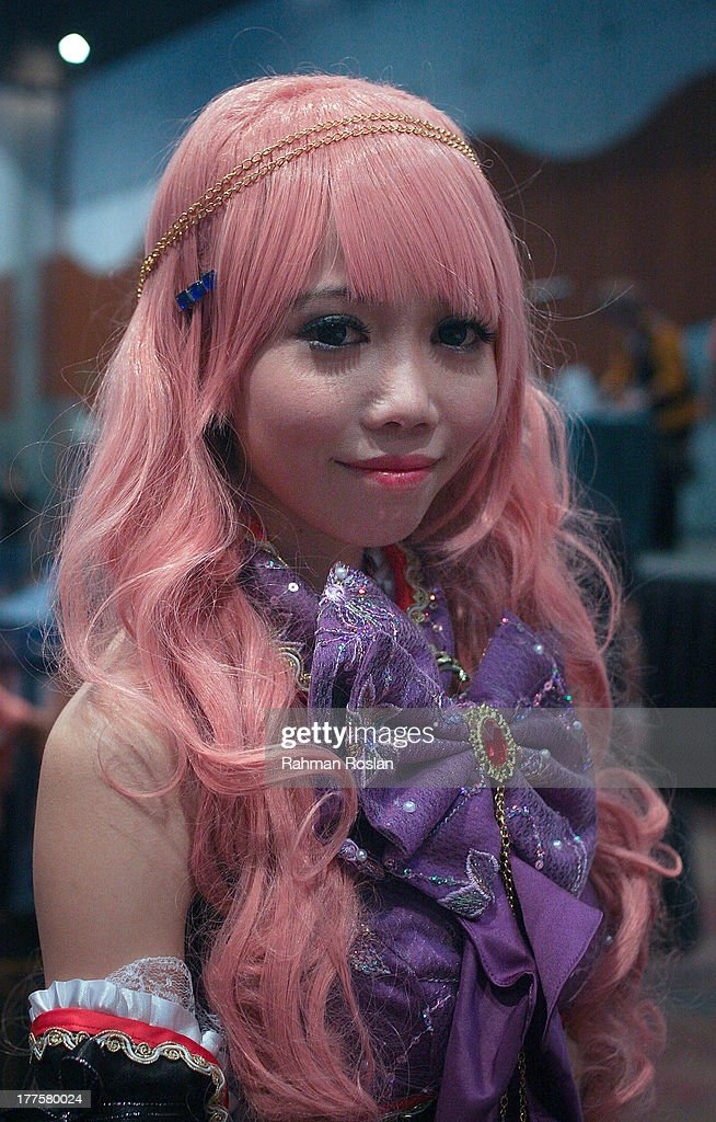 Cosplayer who dresses up as Japanese Manga character poses for a potrait during AniManGaki on August 24, 2013 in Kuala Lumpur, Malaysia. Making its debut in 2009, AniManGaki which abbreviated from the words Anime, Manga and Gaki (Japanese slang for 'brat') was formed by fans, for fans; with the sole purpose of bringing together fans and lovers of anime from all walks of life.