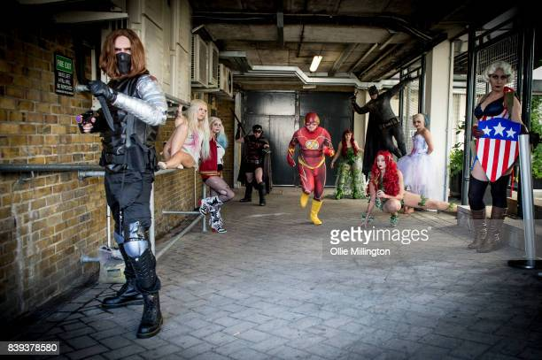 Cosplayers as Batman The Flash Poison Ivy Captain America Harley Quinn Harley Quinn Harley Quinn The Flash Puppet Master Captain America Poisin Ivy...