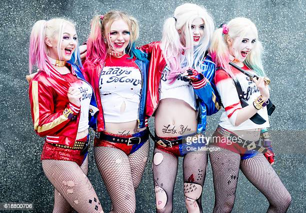 Cosplayers as Harley Quinn from Suicide Squad pose on day 1 of the MCM London Comic Con at ExCel on October 28 2016 in London England