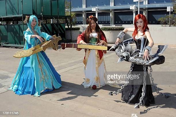 Cosplayers as Sona Goqin from 'League Of Legends' attends the Anime Expo 2013 held at The Los Angeles Convention Center on July 6 2013 in Los Angeles...