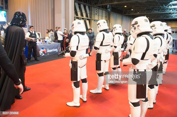 Cosplayers as Stormtroopers under inspection during the MCM Birmingham Comic Con at NEC Arena on March 19 2017 in Birmingham England