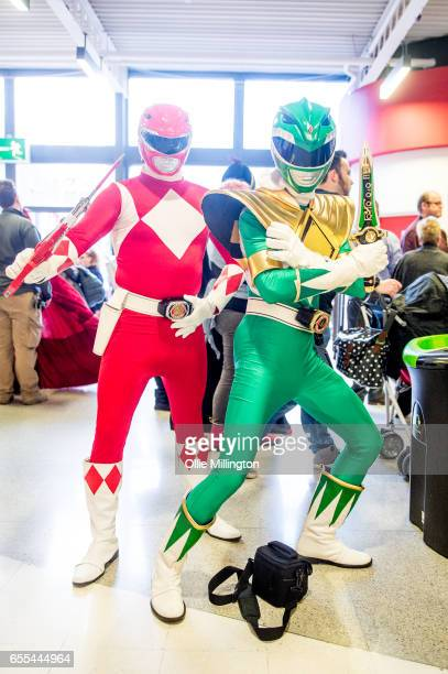 Cosplayers as the red and green Power Rangers during the MCM Birmingham Comic Con at NEC Arena on March 19 2017 in Birmingham England
