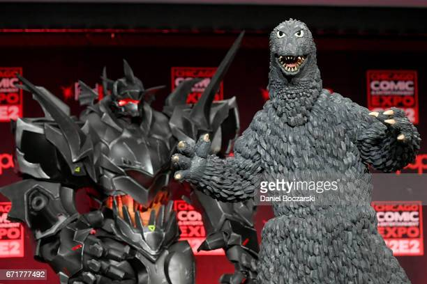 Cosplayers dressed as Blackhardt from 'Overwatch' and Godzilla attends the C2E2 Crown Champions of Cosplay at McCormick Place on April 22 2017 in...