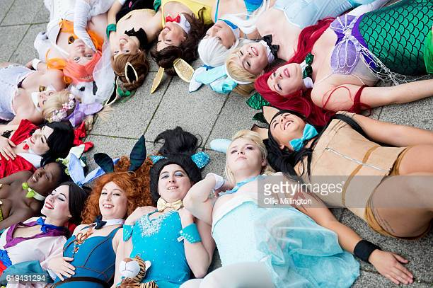 Cosplayers dressed as Disney princess playboy bunnies during day 3 of the MCM London Comic Con at ExCel on October 30 2016 in London England