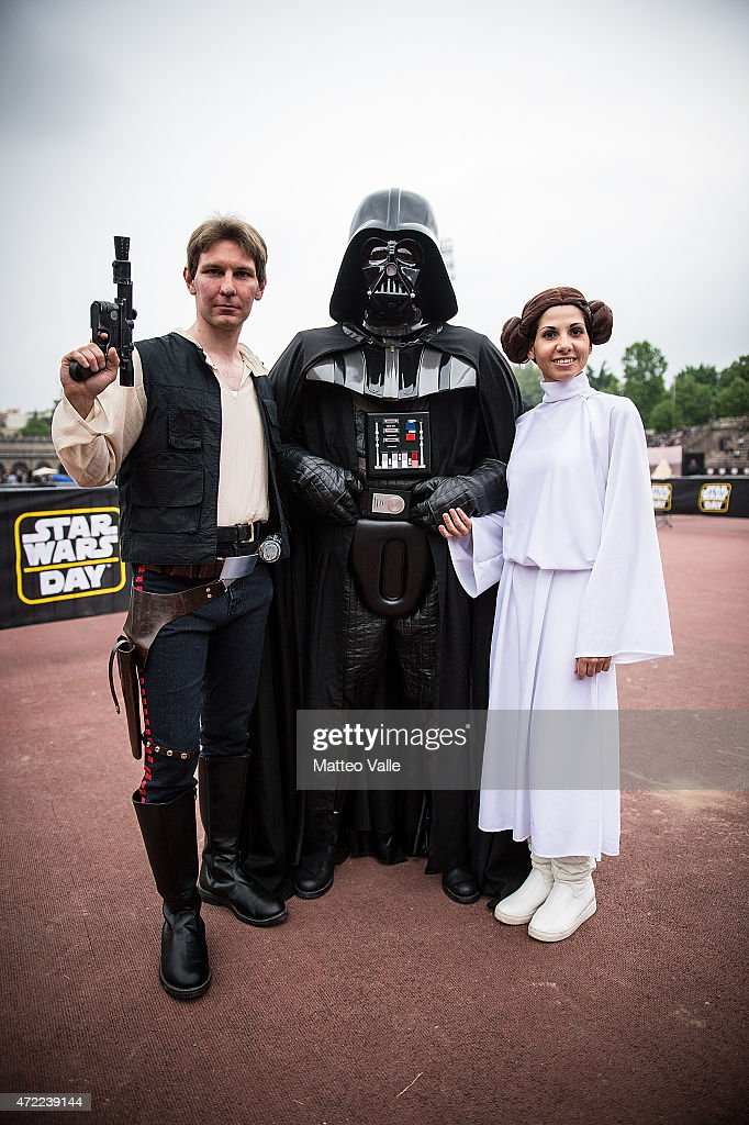 Cosplayers dressed as Han Solo Darth Vader and Princess Leia attend the Star Wars Day event on May 3 2015 in Milan Italy