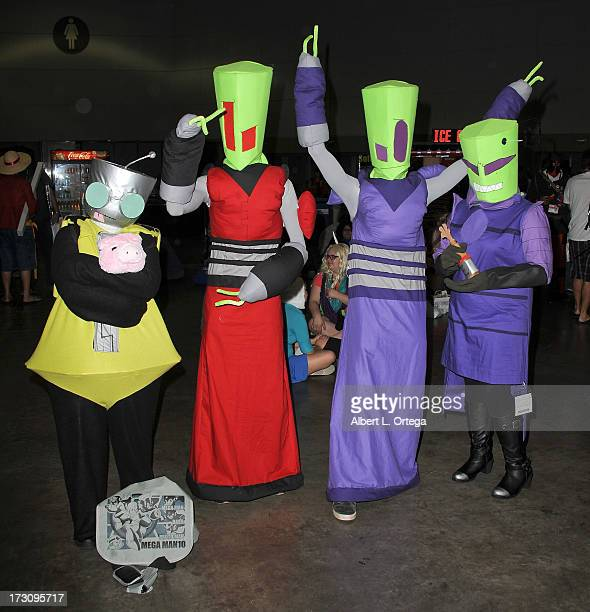 Cosplayers dressed as Invader Zim attend the Anime Expo 2013 held at The Los Angeles Convention Center on July 6 2013 in Los Angeles California