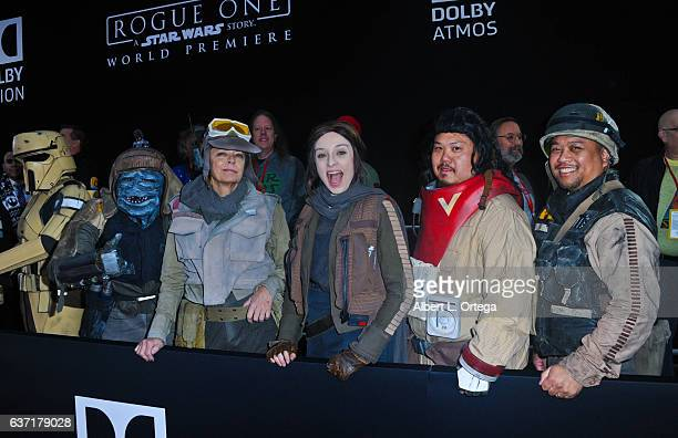 Cosplayers dressed as members of The Rebellion Cassian Andor Jyn Erso and Baze Malbus from Rogue One the Premiere Of Walt Disney Pictures And...