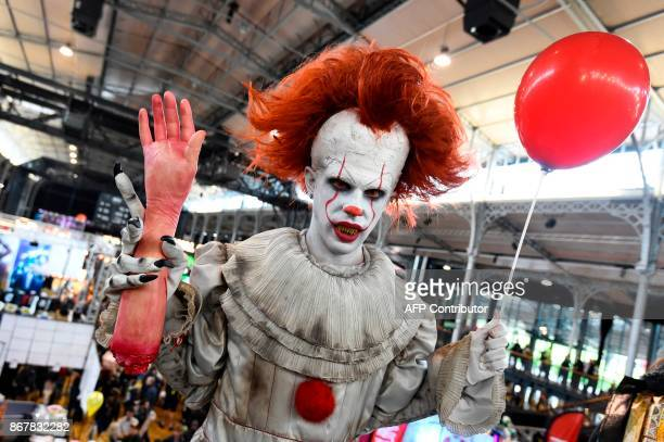 A cosplayers dressed as Pennywise from 'It' poses during the Comic Con festival on October 29 2017 at the Grande Halle de la Villette in Paris / AFP...