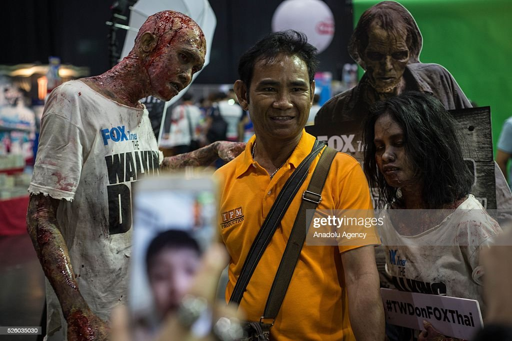 Cosplayers dressed as zombies from the movie series 'Walking Dead' and a visitor pose for a picture during the Bangkok Comic Con 2016 Festival at Bitec Exhibition Centre in Bangkok, Thailand on April 29, 2016. 'Cosplay' imitates characters from comics, video games, anime series and science fiction movies, mostly coming from the Japanese pop culture. Bangkok Comic Con is one of the biggest Pop Culture exhibition in Asia starts from 29 April until 1 May 2016. The event hopes to turn Thailand into a major center for international filmmakers and animators come to create their masterpieces. Comic Con is an internationally renowned event in the world of animation as it started in 1970 in San Diego.