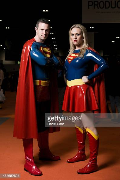 Cosplayers dressed in PVC costumes as Superman and Superwoman attend MCM Comic Con at ExCel convention centre in London England on May 23 2015