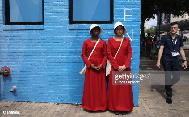 Cosplayers from the television series 'The Handmaid's Tale' are seen during 2017 SXSW Conference and Festivals on March 10 2017 in Austin Texas