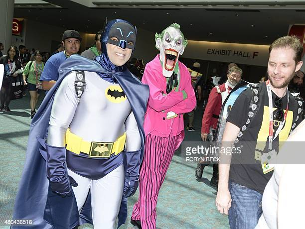 Cosplayers in Batman and Joker costumes attend the third day of Comic Con International in San Diego California July 11 2015 AFP PHOTO / ROBYN BECK