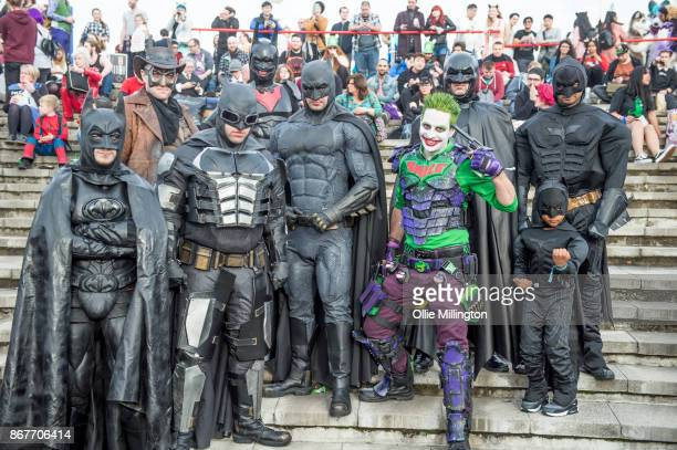 cosplayers in character as The Bat Joker and Batman during MCM London Comic Con 2017 held at the ExCel on October 28 2017 in London England