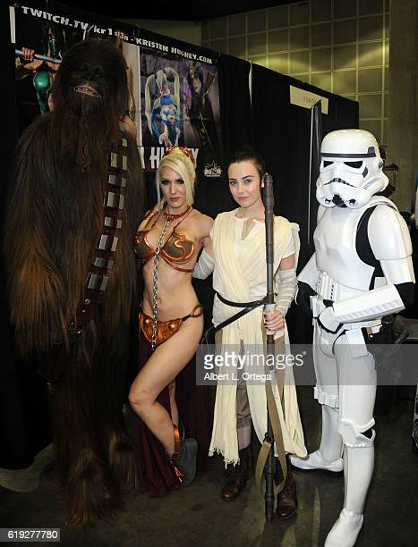 Cosplayers Kristen Hughey and Megan Golden with a Storm Trooper and Chewbacca on day 2 of Stan Lee's Los Angeles Comic Con 2016 held at Los Angeles...