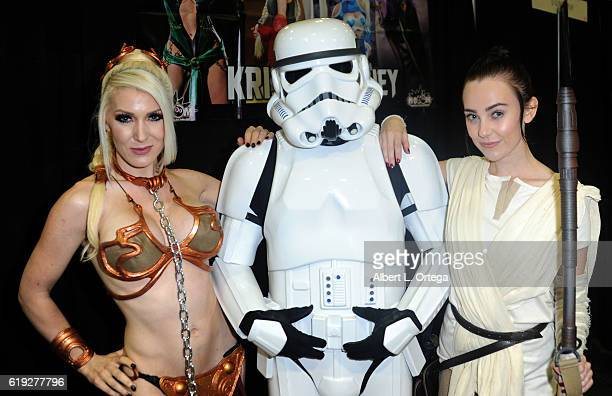 Cosplayers Kristen Hughey and Megan Golden with a Storm Trooper on day 2 of Stan Lee's Los Angeles Comic Con 2016 held at Los Angeles Convention...