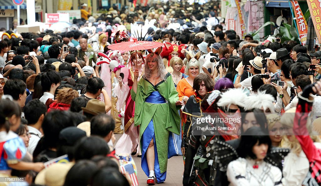 Cosplayers, or Costume Players from 20 countries match on during the World Cosplay Summit Parade on August 4, 2013 in Nagoya, Aichi, Japan.