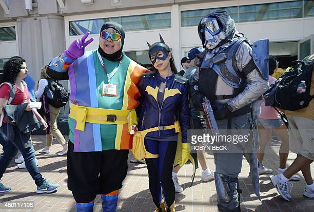 Cosplayers pose for a photo on the first day of Comic Con International in San Diego California July 9 2015 AFP PHOTO / ROBYN BECK