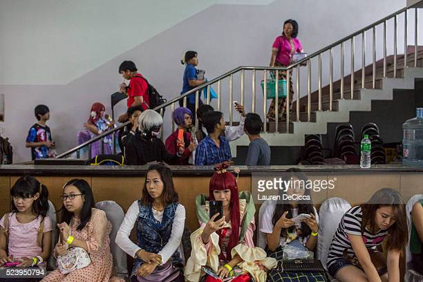 Cosplayers wait for the costume competition to begin on April 24 2016 in Yangon Burma Hundreds of youths between 16 to 24 gathered at Hlaing...