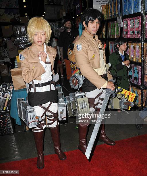 Cosplayers Yuu Zhang and John Zabate attend the Anime Expo 2013 held at The Los Angeles Convention Center on July 6 2013 in Los Angeles California