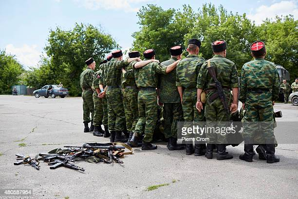 Cossacks army recruits fighting on the side of selfproclaimed Lugansk People's Republic pose in a group as they are swornin on the frontline July 11...