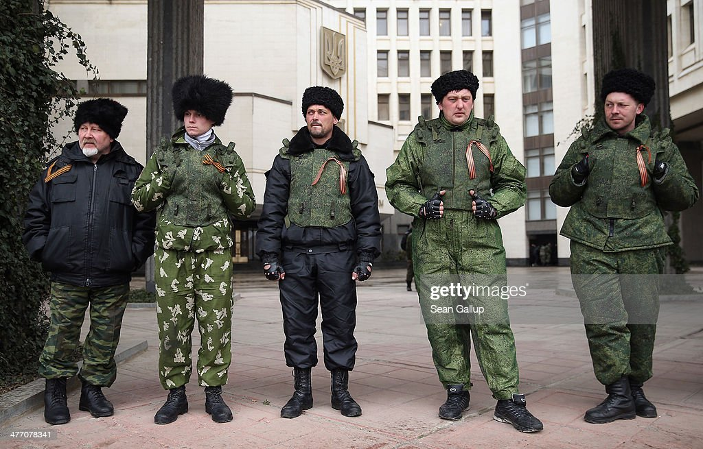 Cossacks stand guard at the entrance to the Crimean Parliament building on March 7, 2014 in Simferopol, Ukraine. Russian Cossacks, some heavily armed, have taken up guard duties at road checkpoints, border crossings and other key facilities that were previously guarded by local, pro-Russian militants across Crimea in recent days. The Crimean Parliament voted yesterday to hold a referendum on March 16 to determine whether Crimea shall secede from Ukraine and join Russia.
