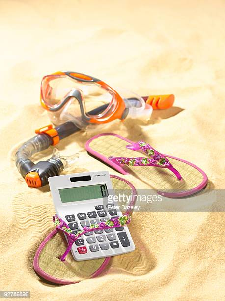 Cost of holiday flip flops, calculator and snorkel