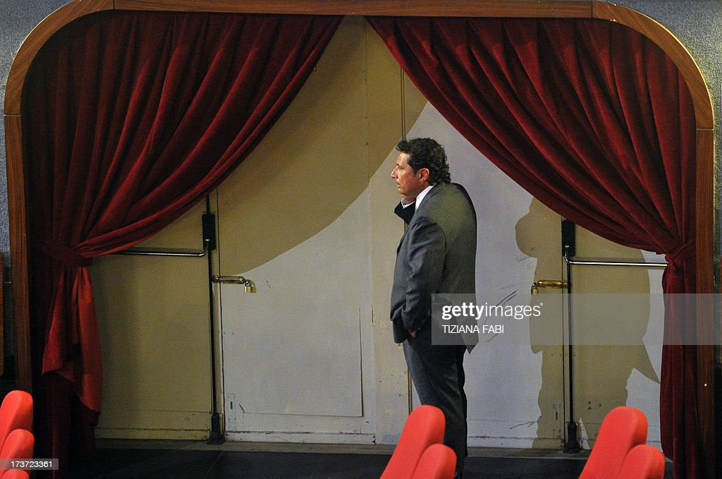 Costa Concordia's captain Francesco Schettino speaks on his mobile phone during a break of his trial on July 17, 2013 in a local theatre in Grosseto. Captain Francesco Schettino, dubbed Italy's 'most hated man' by tabloids over the spectacular crash of his cruise ship in 2012 with the loss of 32 lives, went on trial on Tuesday charged with manslaughter.