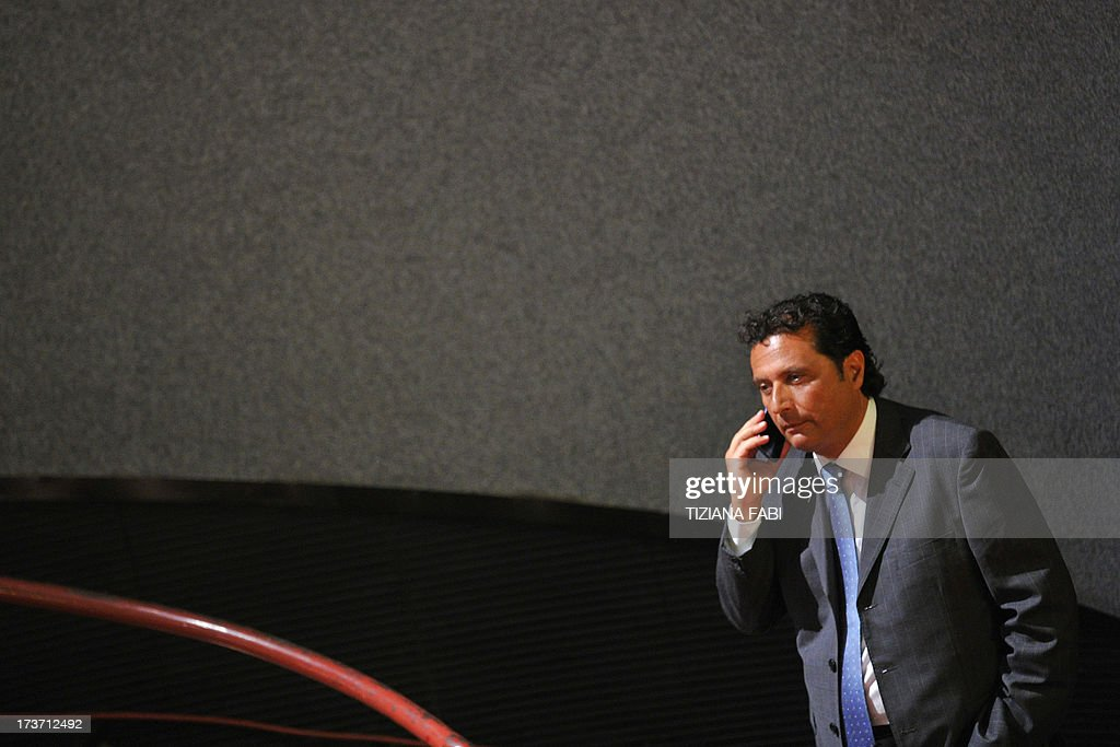 Costa Concordia's captain Francesco Schettino speaks on the phone before his trial on July 17, 2013 in a local theatre in Grosseto. Captain Francesco Schettino, dubbed Italy's 'most hated man' by tabloids over the spectacular crash of his cruise ship in 2012 with the loss of 32 lives, went on trial on Tuesday charged with manslaughter.