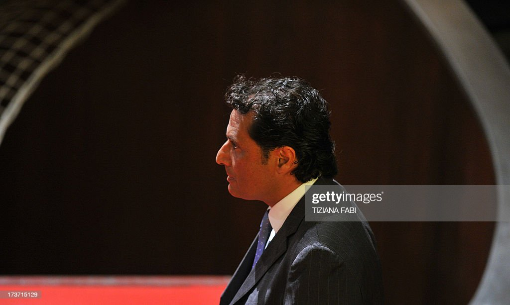 Costa Concordia's captain Francesco Schettino takes place for his trial on July 17, 2013 in a local theatre in Grosseto. Captain Francesco Schettino, dubbed Italy's 'most hated man' by tabloids over the spectacular crash of his cruise ship in 2012 with the loss of 32 lives, went on trial on Tuesday charged with manslaughter. AFP PHOTO / TIZIANA FABI